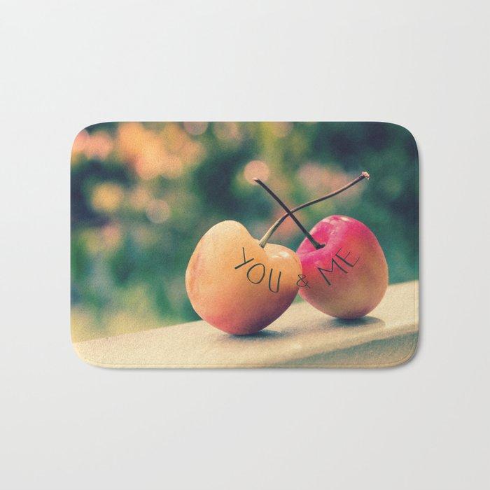 You & Me (Rainier Cherries with Green Bokeh Background) Bath Mat