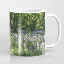 Path through wild Bluebells in ancient woodland. Wayland Wood, Norfolk, UK. Coffee Mug
