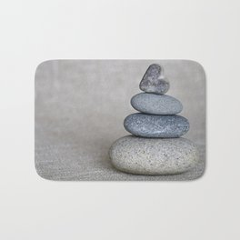 Balanced pebble stack with heart on top Bath Mat