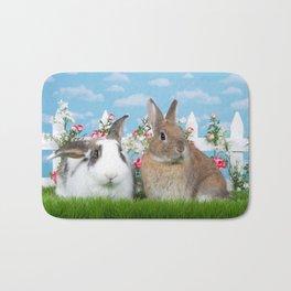 Bunny Love two rabbits in a flower garden Bath Mat