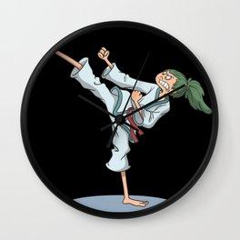 Karate foot kick over head Wall Clock