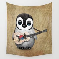 korean Wall Tapestries featuring Baby Penguin Playing South Korean Flag Guitar by Jeff Bartels