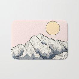 The sun and mountain Bath Mat