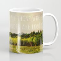 not all those who wander are lost Mugs featuring not all those who wander are lost by Sybille Sterk
