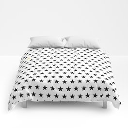 Black stars pattern with single golden star on white Comforters
