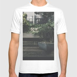 Potted plant on a wooden plank in the garden T-shirt