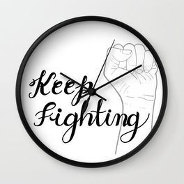 Keep fighting, hand written calligraphy with raised hands up. Wall Clock