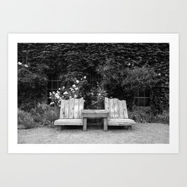 Wooden chairs and table in overgrown garden Art Print