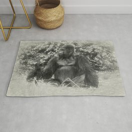 Male gorilla sitting on the ground Rug