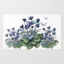 """Spring garden of blue cyclamen and butterflies"" Rug"
