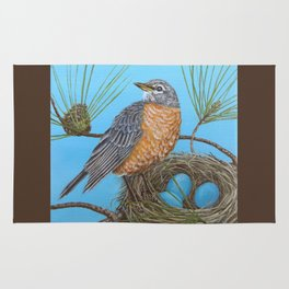 Robin with nest in Georgia pine tree Rug