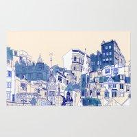 buildings Area & Throw Rugs featuring Blue Buildings by Jordan Kay
