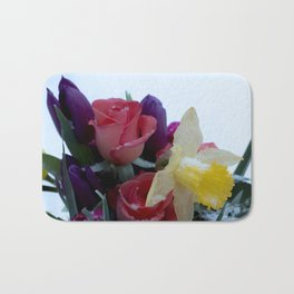 Vibrant bouquet of flowers in the snow Bath Mat