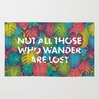 not all those who wander are lost Area & Throw Rugs featuring Not all those who wander are lost by Attitude Creative