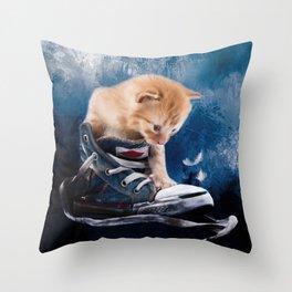 Cute kitten plays in sneakers Throw Pillow