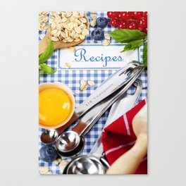 Blue cookbook and kitchenware Canvas Print