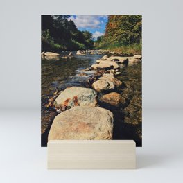 Rock path in the midlle of the river Mini Art Print