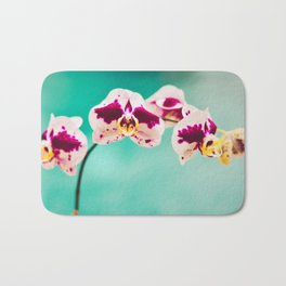 Orchids for an office lobby Bath Mat