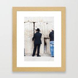 Prayer at the wall Framed Art Print