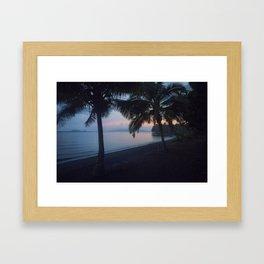 Black sand sunset Framed Art Print