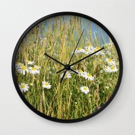 Wildflowers along the lake Wall Clock