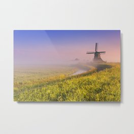 Traditional Dutch windmill at sunrise on a foggy morning Metal Print