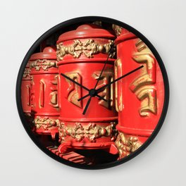 Red prayer drums row Wall Clock