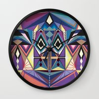 totem Wall Clocks featuring Totem by Naia Ceschin