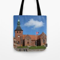 denmark Tote Bags featuring Vor Frue Kirke, Svendborg, Denmark by Anders Riise Koch