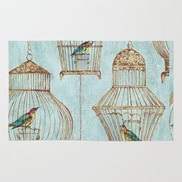 Vintage dream- Exotic colorful birds in cages on teal background Rug