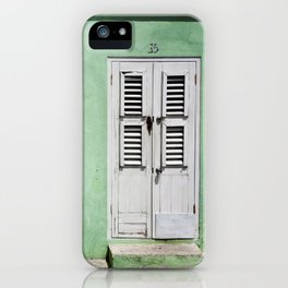 Mint green house in Caribbean iPhone Case