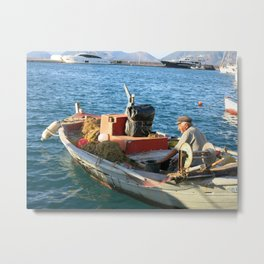 Greek fisherman looks on from boat Metal Print
