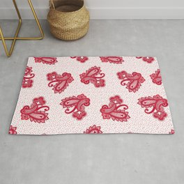 Red paisley clusters on tiny polka dot background Rug