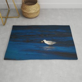 A Seagull With A Lump Of Bread At Dawn Rug