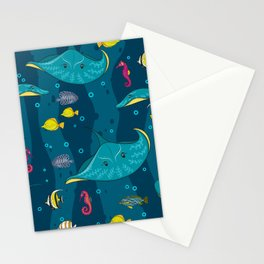 Decorative seamless pattern with sea fish on blue background. Stationery Cards