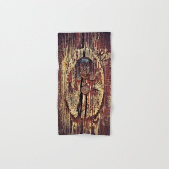weathered wooden door with agypt door knocker Hand & Bath Towel