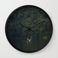 rowing Wall Clocks featuring Rowing back home. by Nepal