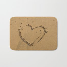 Heart drawn on the sand Bath Mat