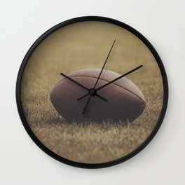 Football Resting in Grassy Turf Aged Effect Wall Clock