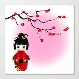 Japanese kokeshi doll at sakura blossoms Canvas Print