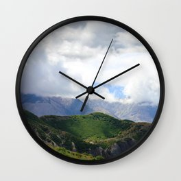 Saint Under The Clouded Sky Wall Clock