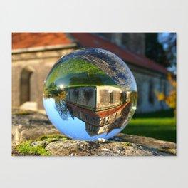 Church seen through glass ball Canvas Print