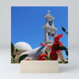 Red hibiscus in front of a greek orthodox church Mini Art Print