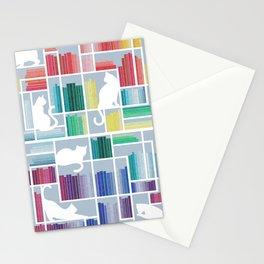 Rainbow bookshelf // pastel blue background white shelf and library cats Stationery Cards