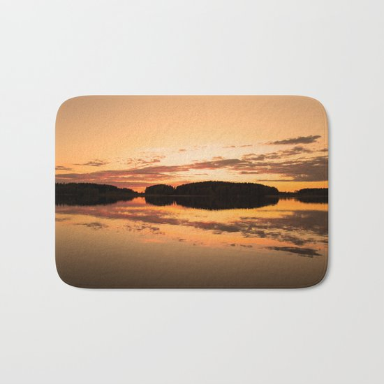 Beautiful sunset - glowing orange - forest silhouette and reflection Bath Mat