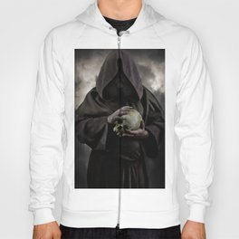 Holding a male skull Hoody