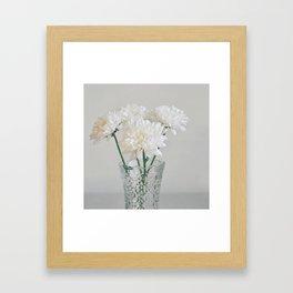 Creamy white flowers in clear vase. Framed Art Print