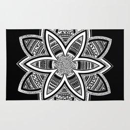 wholeness white mandala on black Rug