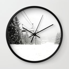 Lifts waiting for action in the snow Wall Clock