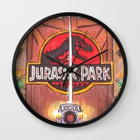jurassic park Wall Clocks featuring Jurassic Park by Humble Dino